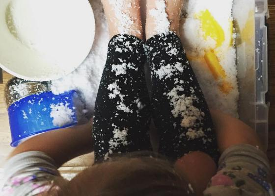 indoor sensory play in snow during dinner time